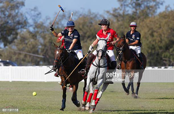 Francesca Cumani and Zara Phillips compete for the ball at the Magic Millions Polo Event on January 8 2017 in Gold Coast Australia