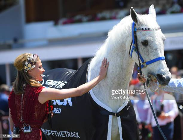 Francesca Cumani gives retired champion Subzero a pat before he lead the field out in Race 3 Off the Track Subzero Handicap on 2017 Oaks Day at...