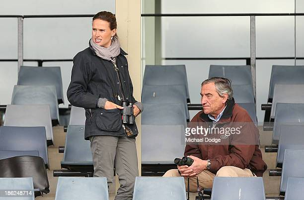 Francesca Cumani looks ahead with father and trainer of Mount Athos Luca Cumani while the horse gallops during trackwork at Werribee Racecourse on...