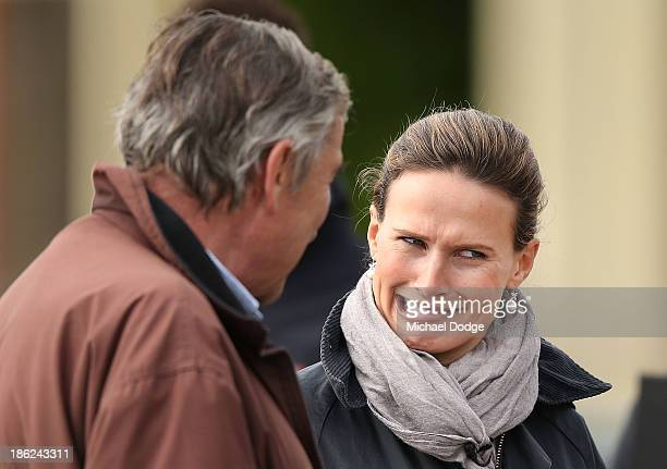 Francesca Cumani reacts when speaking to her father and trainer of Mount Athos, Luca Cumani, after the horse galloped during trackwork at Werribee...