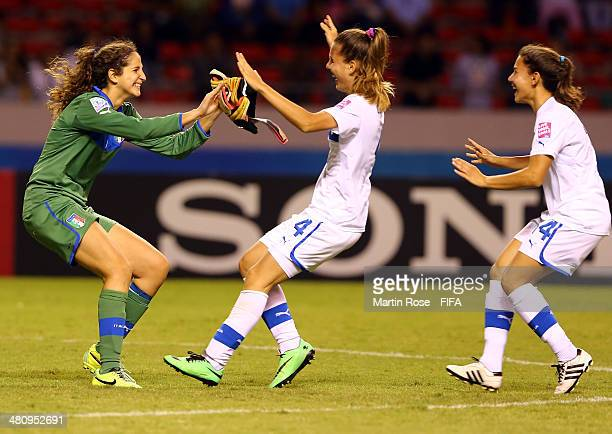 Francesca Durante golkeeper of Italy celebrate with her team mate after winning the penalty shot out during the FIFA U17 Women's World Cup 2014...