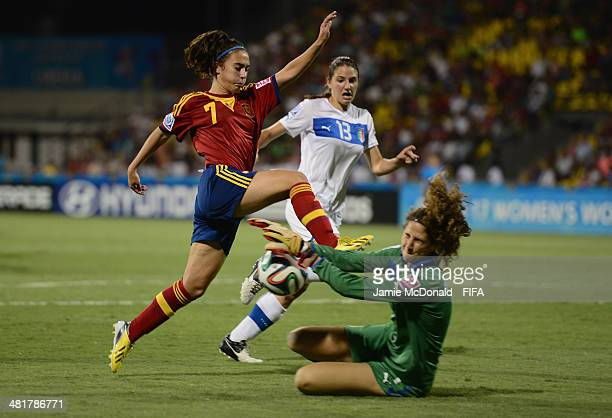 Francesca Durante of Italy saves at the feet of Nahikari Garcia of Spain during the FIFA U17 Women's World Cup Semi Final match between Italy and...