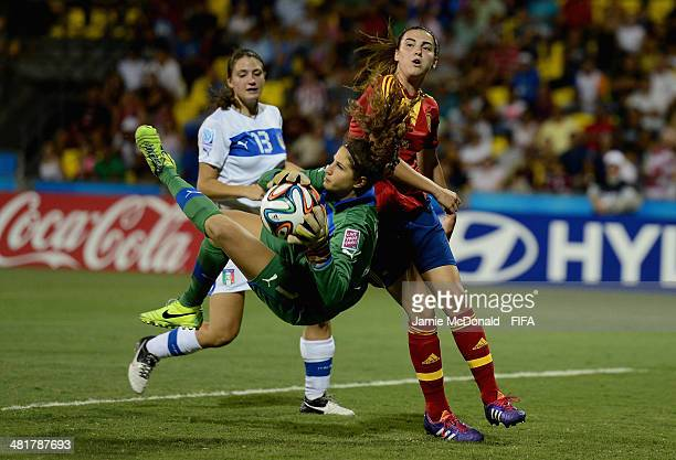 Francesca Durante of Italy saves from Patri Guijarro of Spain during the FIFA U17 Women's World Cup Semi Final match between Italy and Spain at...