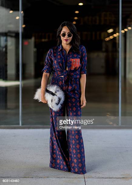 Francesca Felix is wearing House of Harlow 1960 x Revolve top and pants with Michael Kors collection bag on September 11 2016 in New York City