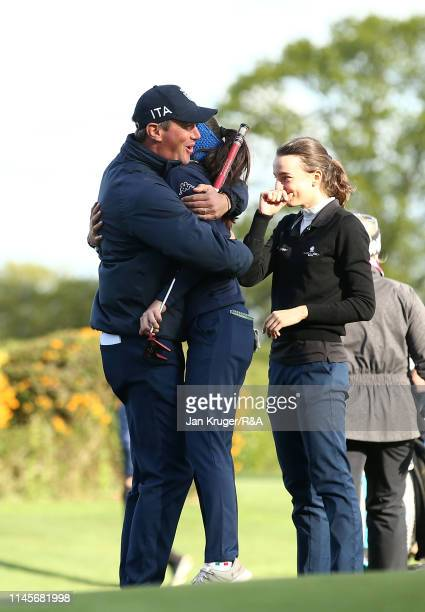 Francesca Fiorellini of Italy celebrates with team mates during the final round of the R&A Girls U16 Amateur Championship at Fulford Golf Club on...