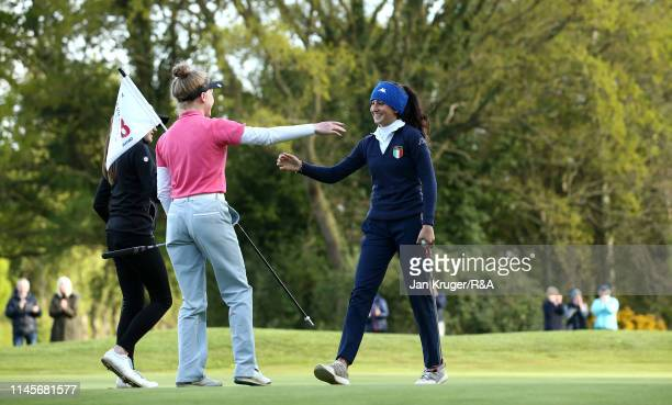 Francesca Fiorellini of Italy is congratulated on the 18th by playing partner Maggie Whitehead during the final round of the R&A Girls U16 Amateur...