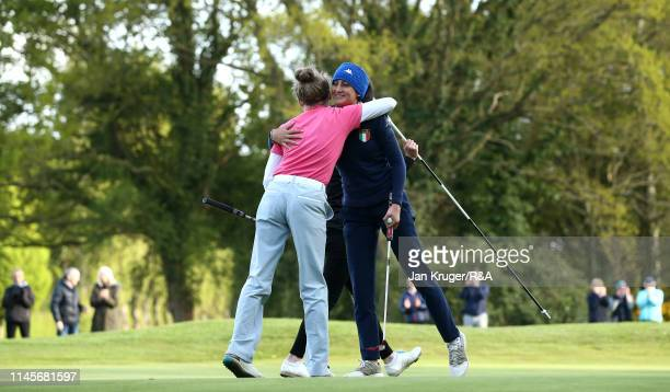 Francesca Fiorellini of Italy is congratulated on the 18th by playing partner Maggie Whitehead during the final round of the RA Girls U16 Amateur...