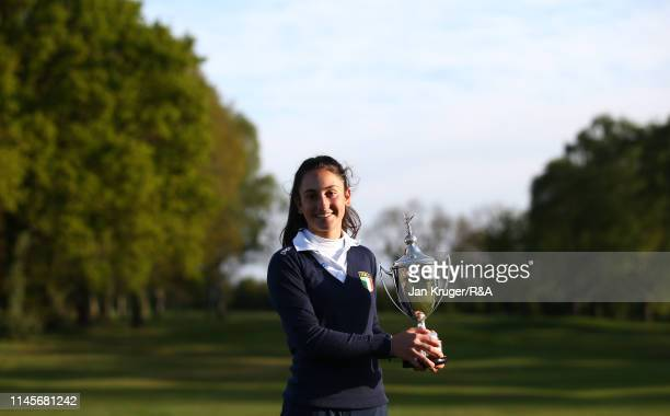 Francesca Fiorellini of Italy poses with the winners trophy following victory during the final round of the RA Girls U16 Amateur Championship at...