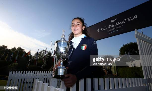 Francesca Fiorellini of Italy poses with the winners trophy following victory during the final round of the R&A Girls U16 Amateur Championship at...