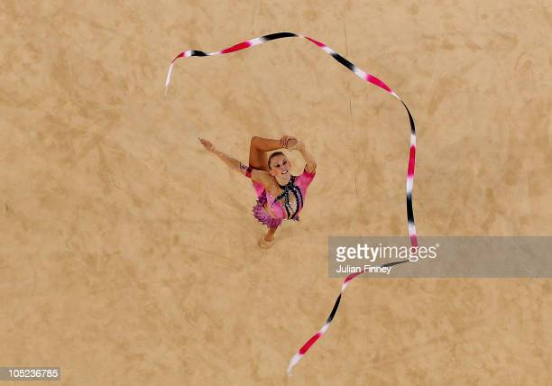 Francesca Fox of England performs with the ribbon as she competes in the in the AllAround Rhythmic Gymnastics Final at Indira Gandhi Sports Complex...