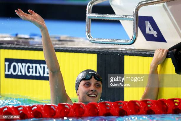Francesca Halsall of England celebrates winning the gold medal in the Women's 50m Butterfly Final at Tollcross International Swimming Centre during...