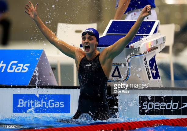 Francesca Halsall of Loughborough University S WPC looks at the scoreboard after winning the Women's 50m Freestyle Final during day eight of the...