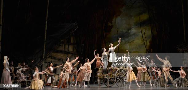 Francesca Hayward as Giselle and Alexander Campbell as Albrecht with artists of the company in the Royal Ballet's production of Peter Wright's...