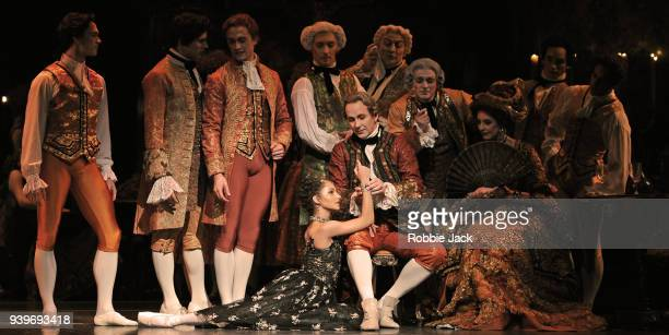 Francesca Hayward as Manon and Christopher Saunders as Monsieur GM with artists of the company in the Royal Ballet's production of Kenneth...