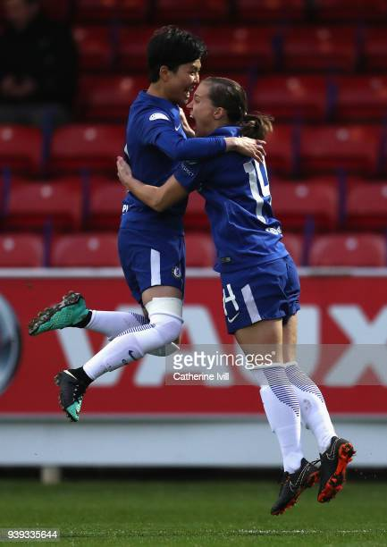 Francesca Kirby of Chelsea is congratulated by teammate SoYun Ji after scoring during the UEFA Womens Champions League QuarterFinal second leg match...