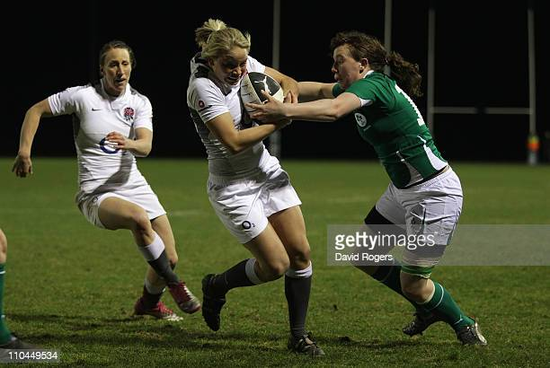 Francesca Matthews is tackled by Niamh Kavanagh during the Womens Six Nations match between Ireland and England at Ashbourne Rugby Club on March 18...
