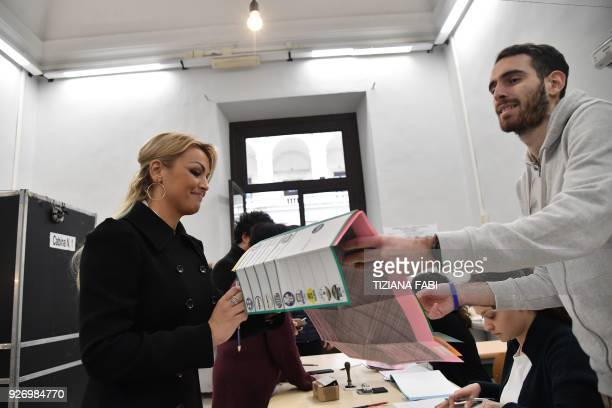 Francesca Pascale companion of Silvio Berlusconi leader of rightwing party Forza Italia prepares to vote for general elections on March 4 2018 in...