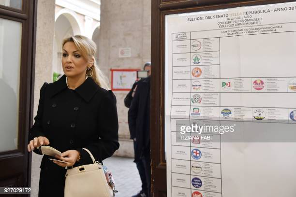 Francesca Pascale companion of Silvio Berlusconi leader of rightwing party Forza Italia arrives at a polling station to vote for general elections on...