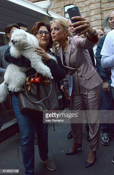 Francesca Pascale girlfriend of Forza Italia president Silvio Berlusconi takes photos with supporters during a visit with Berlusconi in support of...