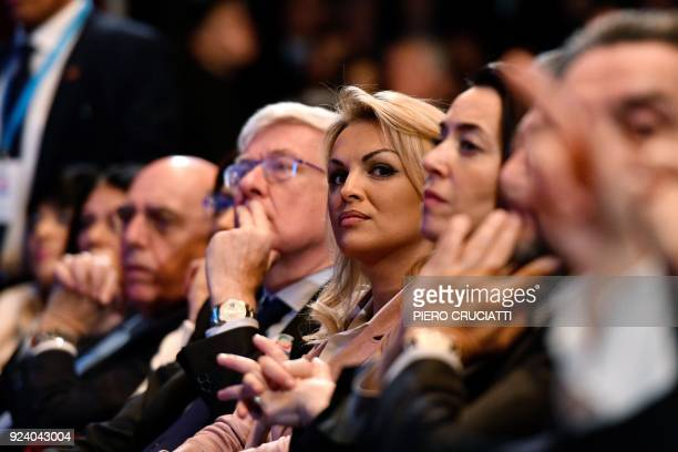 Francesca Pascale the companion of the leader of the Italian rightwing party Forza Italia Silvio Berlusconi listens to Berlusconi speech as she sits...