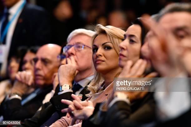 Francesca Pascale , the companion of the leader of the Italian right-wing party Forza Italia Silvio Berlusconi, listens to Berlusconi speech as she...