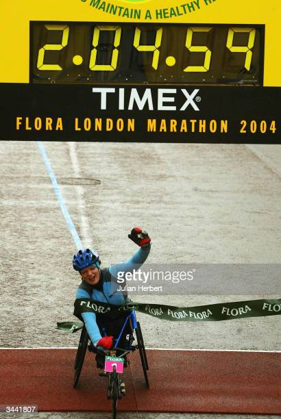 Francesca Porcellato of Italy crosses the line to win the ladies wheelchair competition at the finish of The Flora London Marathon held on April 18...