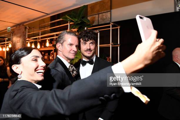 Francesca Rocco Alexander Werz and Giovanni Masiero attend the amfAR Gala at Palazzo Mezzanotte on September 21 2019 in Milan Italy
