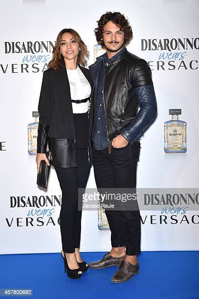 Francesca Rocco and Giovanni Masiero attend Disaronno Wears Versace on October 24 2014 in Milan Italy