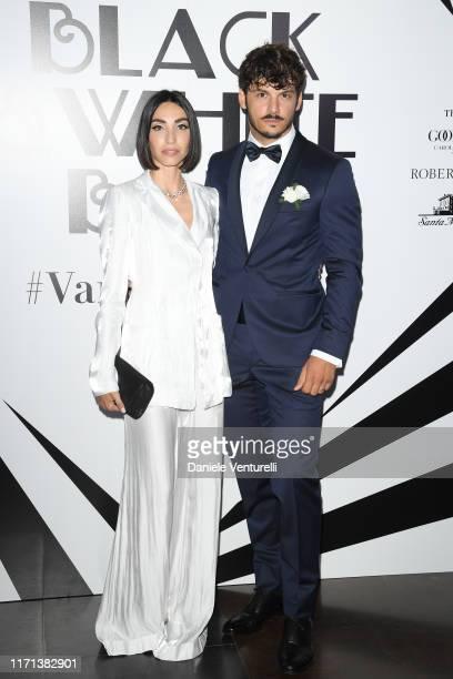 Francesca Rocco and Giovanni Masiero attend the Vanity Fair Black And White Ball Photocall during the 76th Venice Film Festival at Scuola Grande...