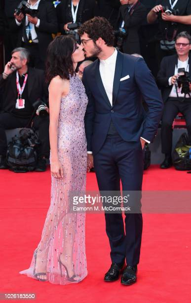 Francesca Rocco and Giovanni Masiero walk the red carpet ahead of the 'The Sisters Brothers' screening during the 75th Venice Film Festival at Sala...