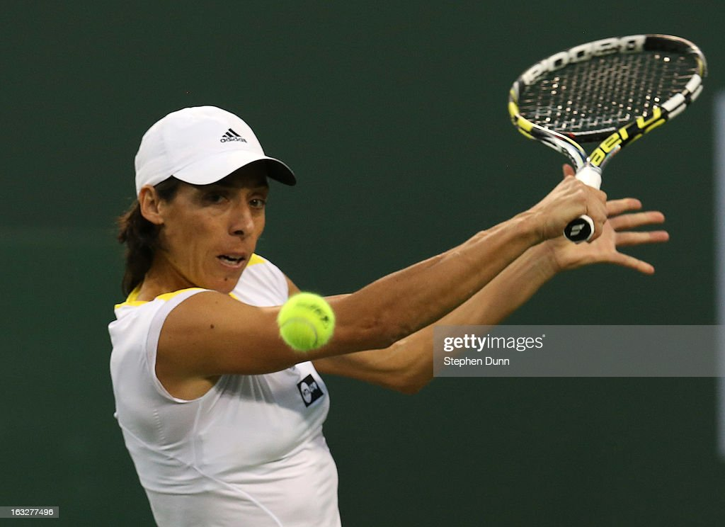 Francesca Schia of Italy returns to Flavia Pennetta of Italy during day 1 of the BNP Paribas Open at Indian Wells Tennis Garden on March 6, 2013 in Indian Wells, California. .