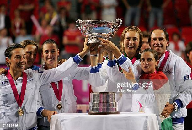 Francesca Schiavone, Flavia Pennetta, Mara Santangelo, Roberta Vinci and Coach Corrado Barazzutti of Italy celebrate defeating Belgium after the Fed...