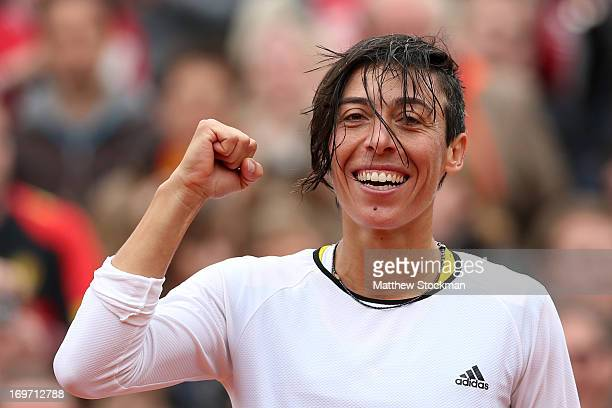 Francesca Schiavone of celebrates match point in her Women's Singles match against Kirsten Flipkens of Belgium on day six of the French Open at...
