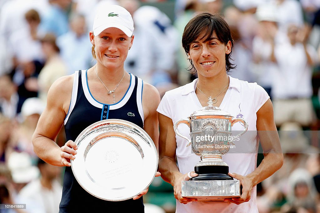 Francesca Schiavone of Italy and Samantha Stosur of Australia pose with their trophies after the women's singles final match between Francesca Schiavone of Italy and Samantha Stosur of Australia on day fourteen of the French Open at Roland Garros on June 5, 2010 in Paris, France.