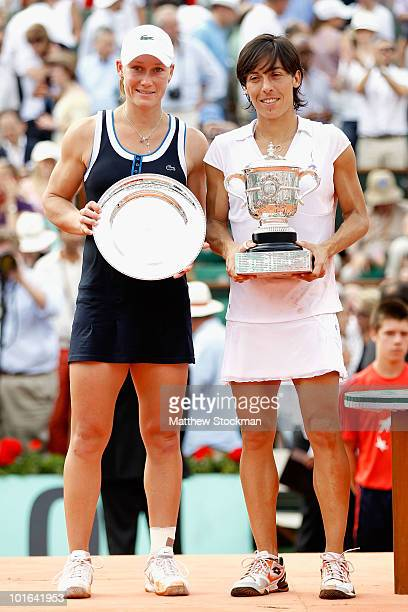 Francesca Schiavone of Italy and Samantha Stosur of Australia pose with their trophies after the women's singles final match between Francesca...