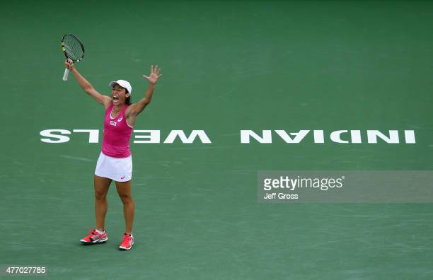 Francesca Schiavone of Italy celebrates after breaking Mona Barthel of Germany in the first set during the BNP Paribas Open at Indian Wells Tennis...