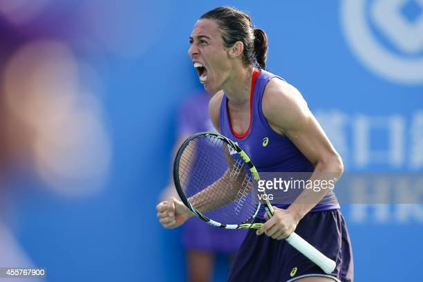 Francesca Schiavone of Italy celebrates after winning the qualifying match against Alison Van Uytvanck of Belgium prior to the start of 2014 WTA...