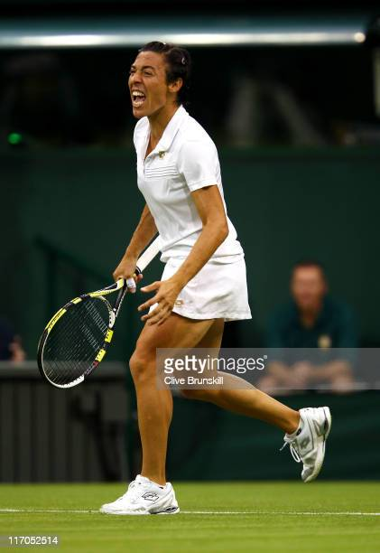 Francesca Schiavone of Italy celebrates match point during her first round match against Jelena Dokic of Australia on Day One of the Wimbledon Lawn...