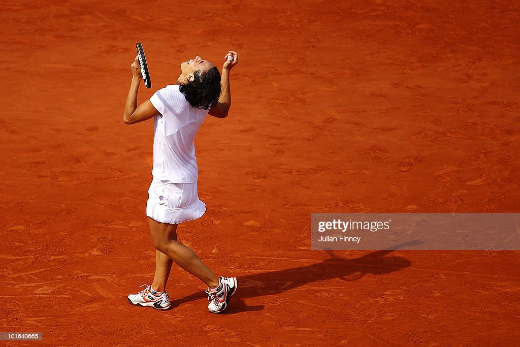 Francesca Schiavone of Italy celebrates winning championship point during women's singles final match between Francesca Schiavone of Italy and Samantha Stosur of Australia on day fourteen of the French Open at Roland Garros on June 5, 2010 in Paris, France.