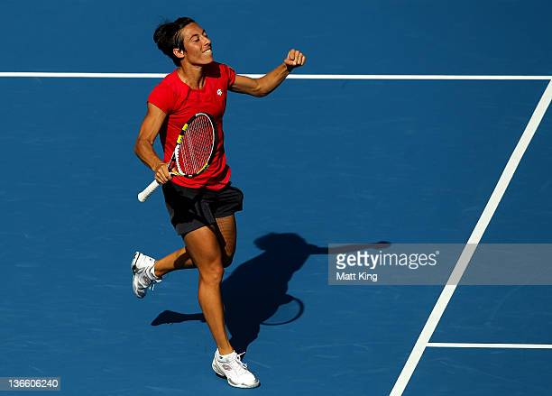 Francesca Schiavone of Italy celebrates winning match point in her first round singles match against Samantha Stosur of Australia during day two of...