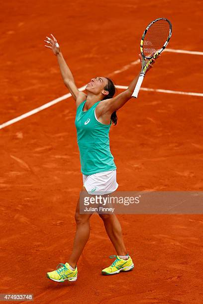 Francesca Schiavone of Italy celerates match point in her Women's Singles match against Svetlana Kuznetsova of Russia on day five of the 2015 French...