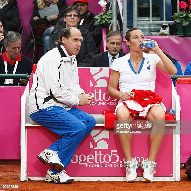 Francesca Schiavone of Italy drinks next her team captain Corrado Barazzutti during the Final match of the Fed Cup World Group between Italy and the...