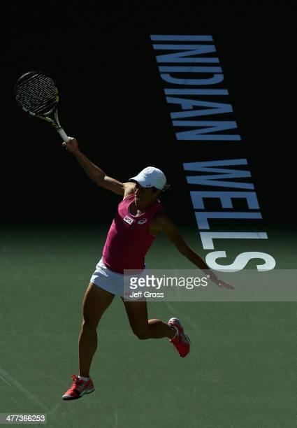 Francesca Schiavone of Italy follows through on a backhand to Samantha Stosur of Australia during the BNP Paribas Open at Indian Wells Tennis Garden...