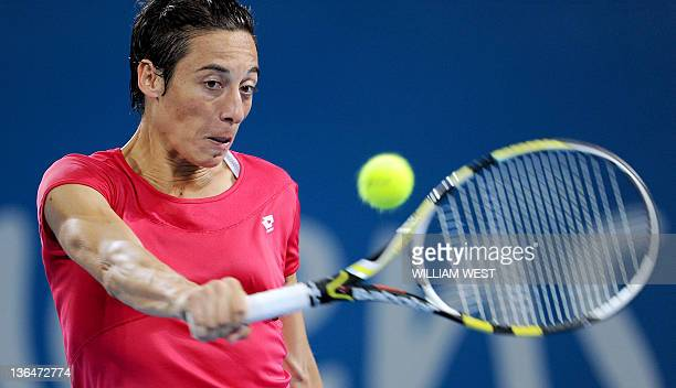 Francesca Schiavone of Italy hits a backhand return during her semifinal match loss to Kaia Kanepi of Estonia at the Brisbane International tennis...