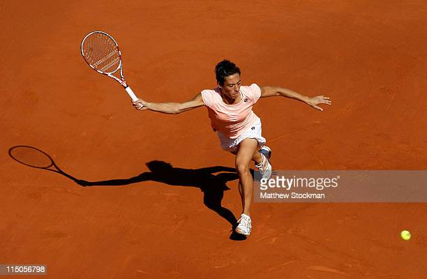Francesca Schiavone of Italy hits a forehand during the women's singles semi final match between Marion Bartoli of France and Francesca Schiavone of...