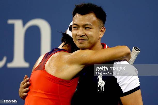 Francesca Schiavone of Italy hugs a ball boy during her first round women's singles match against Serena Williams of the United States of America on...