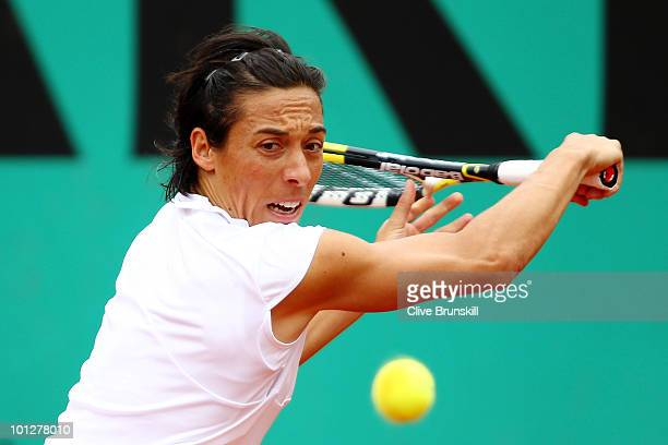 Francesca Schiavone of Italy plays a backhand during the women's singles fourth round match between Francesca Schiavone of Italy and Maria Kirilenko...