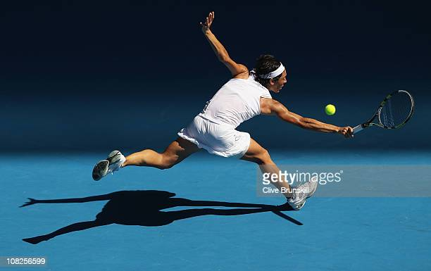 Francesca Schiavone of Italy plays a backhand in her fourth round match against Svetlana Kuznetsova of Russia during day seven of the 2011 Australian...