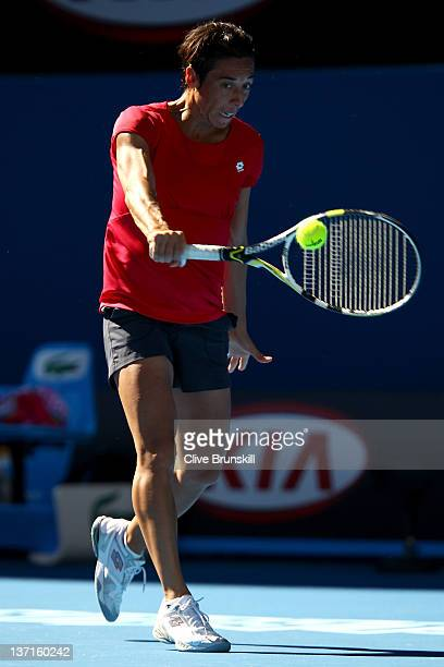 Francesca Schiavone of Italy plays a backhand in her match against Laura PousTio of Spain during day one of the 2012 Australian Open at Melbourne...