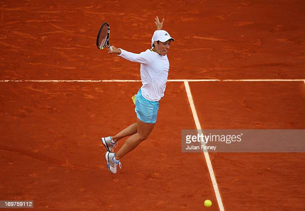 Francesca Schiavone of Italy plays a backhand in her Women's Singles match against Marion Bartoli of France during day seven of the French Open at...